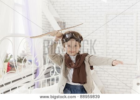happy boy with airplane in hand