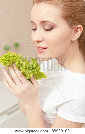 Lady smiles while looking at salad