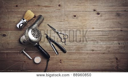 Vintage Barber Equipment On Wood Desk With Place For Text