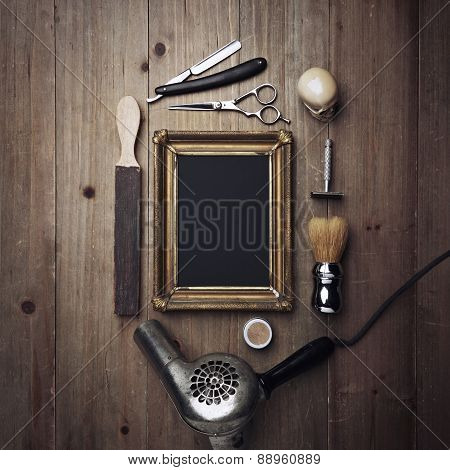 Vintage Barber Tools And Black Poster With A Frame