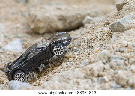 Car (small) toys on sand background