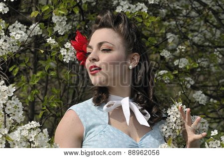 Pin Up Girl With A Dogwood Tree In The Spring
