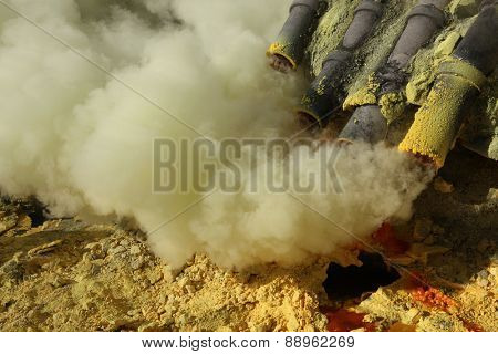 Toxic volcanic gas at the sulphur mines in the crater of the active volcano of Kawah Ijen, East Java, Indonesia