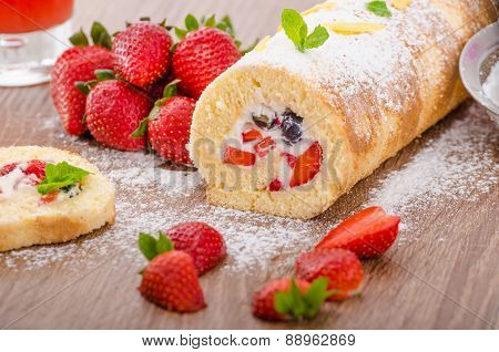 Sponge Roll With Strawberries And Blueberries