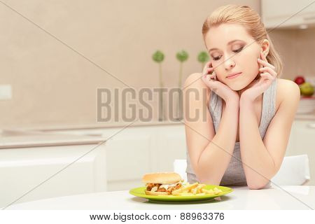 Young woman and fast-food lunch