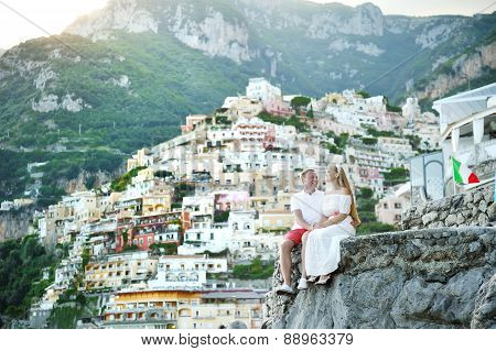 Young Couple Bride And Groom Relaxing In Positano, Amalfi Coast, Italy
