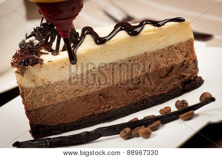 Chocolate cake with syrup, vanilla and coffee beans