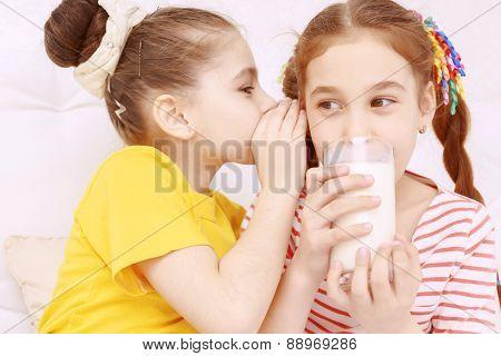 Bright dressed children drinking milk