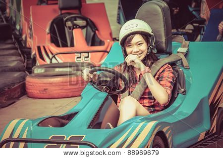 Cute Thai Girl Is Driving Go-kart From The Starting Point In Vintage Color