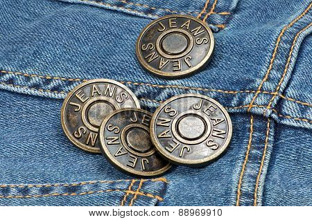 Jeans Metal Buttons On Denim.