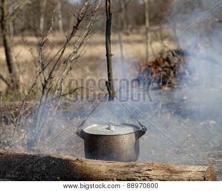 Cooking In Sooty Cauldron On Campfire