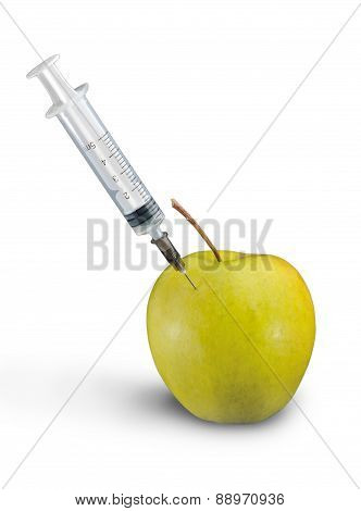 Plastic Syringe In Green Apple.