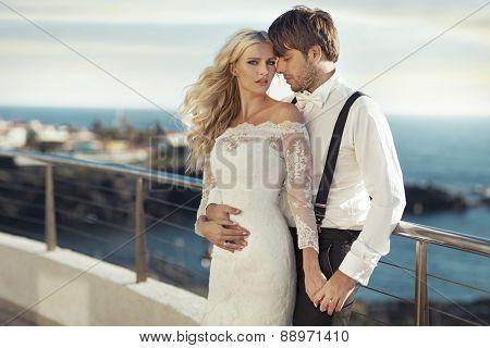 Happy couple on sea-coast