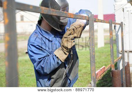 Welder Hammering