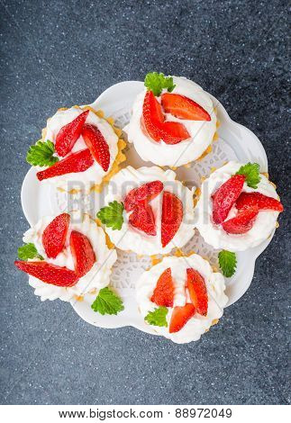 Delicious Cupcake With Whipped Cream And Fresh Strawberries