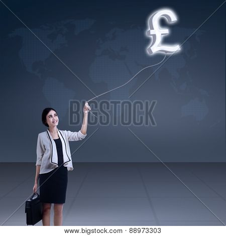 Businesswoman With A Pound Symbol
