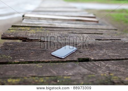 Black Phone On The Brown Old Wood Plank Wall Texture Background