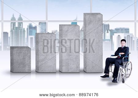 Disabled Businessman With Business Chart