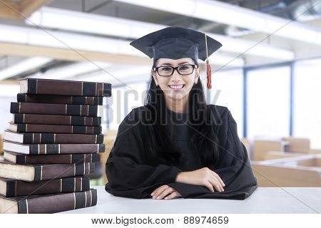 Female Bachelor And Book In Library 1