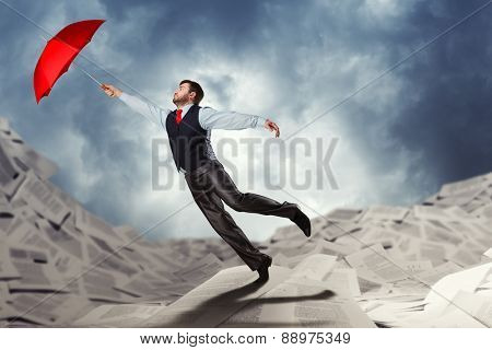 Man flying with umbrella
