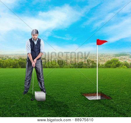 Businessman playing golf