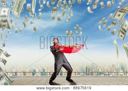Businessman surrounded with money