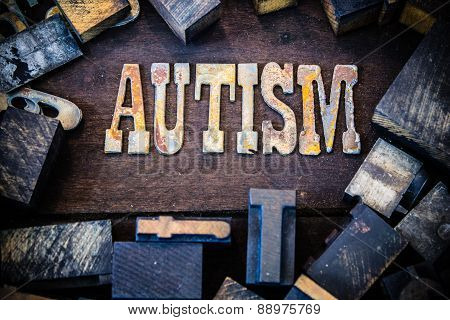 Autism Concept Wood And Rusted Metal Letters