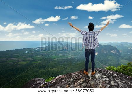 Man Enjoy Fresh Air At Mountain Peak