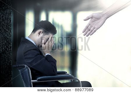 Man On Wheelchair With Helping Hands