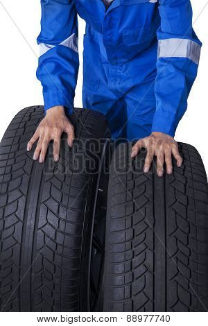 Mechanic With Two Black Tires