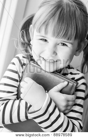 Happy Little Girl Holding A Book