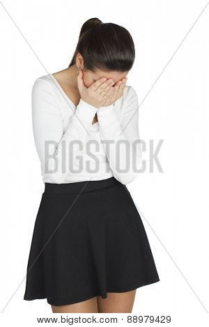 Young woman covers her face with her hands in grief, isolated on white background