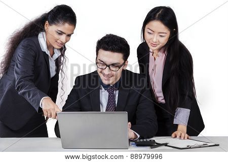 Teamwork In Business Meeting With Laptop