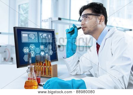 Thoughtful Scientist Working In The Lab