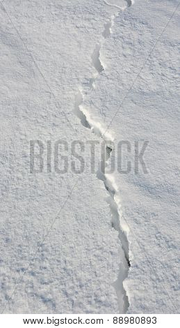 Fissure On The Snow. Picture Can Be Used As A Background