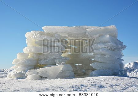 House From Ice- Polar Landscape, Blue Sky As A Background