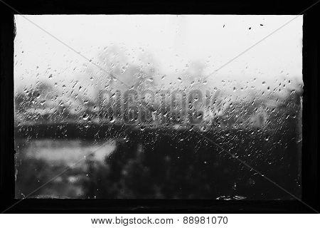 Rain Drops On Glass In Frame