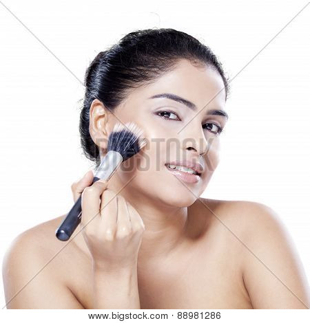 Woman With Clean Skin Using Makeup