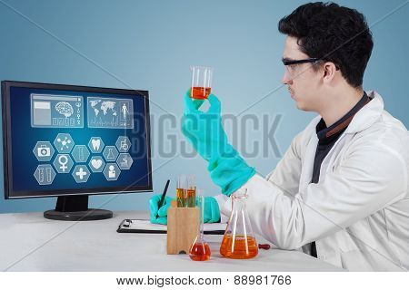 Young Scientist Doing Research In The Lab
