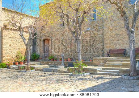 Panoramic View Of Tipical Water Dispenser And Church Near Matera Under Blue Sky
