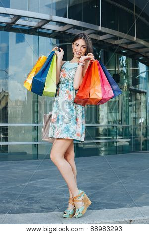 Attractive Woman Posing With Shopping Bugs In Front Of The Shopping Center