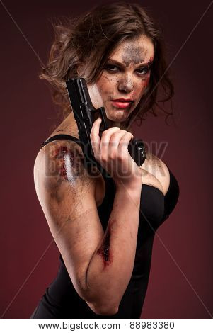 Amazon girl in a black dress holding a gun