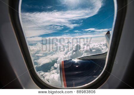 Classic image through aircraft window onto jet engine