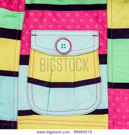 Patch pocket close-up on a colorful background