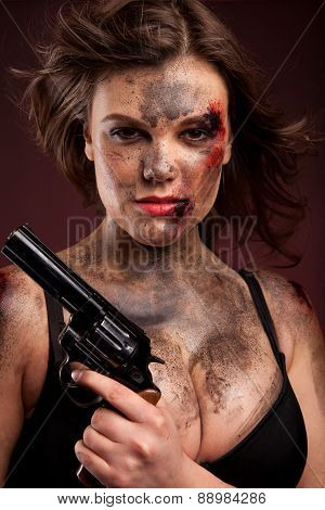 Beautiful, hot and sexy woman with gun. Riot girl.