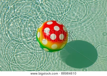 Rubber ball with spots in water