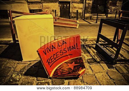 Thrown Out Seat With Viva La Recession Writing And A Red Star At Night In Street