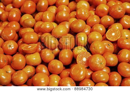 Pile Of Organic Tangerines At Market Stall