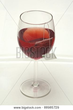 Tea And Teabag In Wine Glass