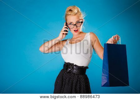 Pin Up Woman With Shopping Bag And Phone.